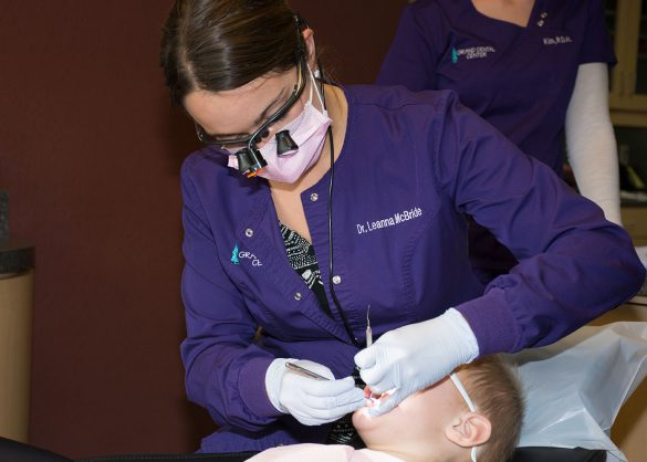 Dr. Leanna McBride checks a young patient for dental cavities.