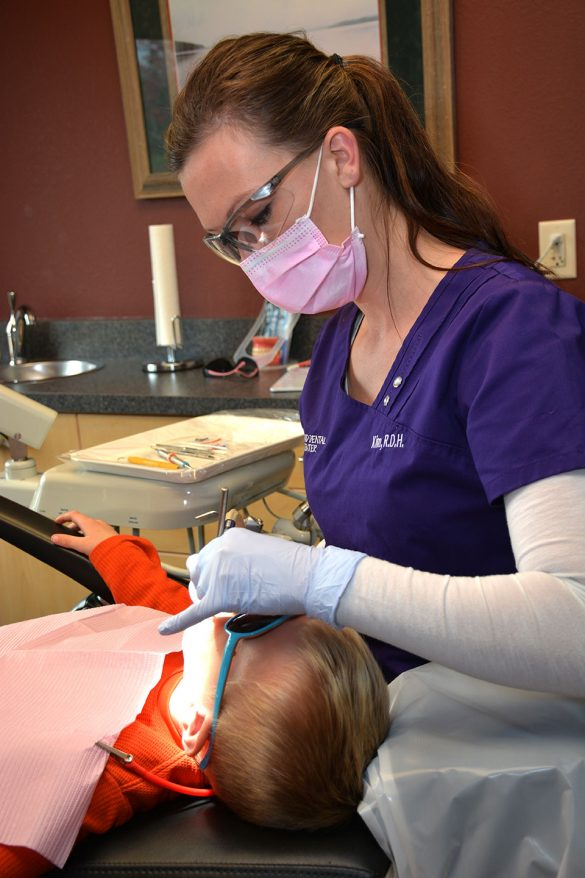 A young boy gets a cavity filled at Grand Dental Center.